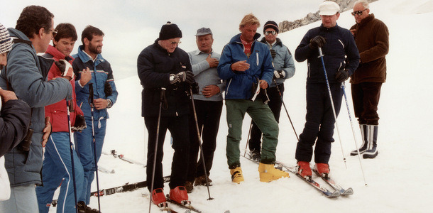 Pope John Paul II (center, in red boots) prays with a group of skiers before heading down a slope in this 1984 file photo. The pontiff, who enjoyed skiing in his native Poland before his election, was able to slip away to ski only a few times as he led the worldwide church. (CNS photo from the Vatican) (Feb. 10, 2005)